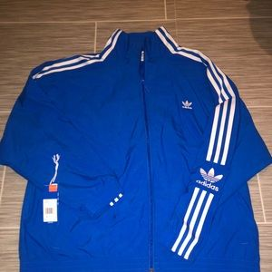 Blue tracksuit top